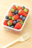 Healthy lunch box with strawberry and blueberry mix Royalty Free Stock Image