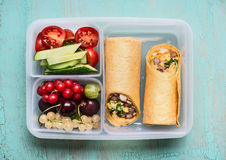 Healthy lunch box with tortilla wraps , fruits and vegetables Royalty Free Stock Photography