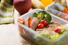 Healthy lunch boxes in plastic package, Grilled chicken breast with sweet potato, egg and vegetable salad, fruit, orange juice. Diet food concept stock photos