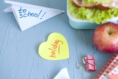 Healthy lunch boxes with sandwich, fresh vegetables, fruits and background. From top view stock photo