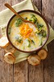 Healthy lunch broccoli cheese soup in a bowl with toast close-up. Vertical top view. Healthy lunch broccoli cheese soup in a bowl with toast close-up on the royalty free stock images