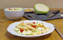 Healthy lunch consists of celery chips, cabbage, corns and tomatoes Royalty Free Stock Image