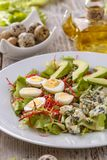 Healthy lunch plate. Avocado, quail egg and blue cheese salad Stock Photography