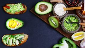 Healthy lunch snack, three delicious avocado sandwiches, fresh sliced avocados, pepper, lemon, sesame, avocado, garlic, honey, kiw royalty free stock photos