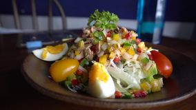 Healthy lunch. Tuna salad with different vegetables. Healthy lunch. Tuna salad with egg and different vegetables, tomato cherry, onion, cabbage stock video