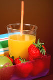 Healthy lunchbox. Containing orange juice, apple and strawberries Stock Photography