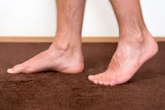 Healthy male feet feeling comfortable Royalty Free Stock Photo