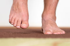 Healthy male feet stepping royalty free stock image