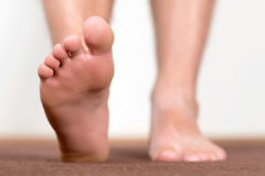 Healthy male feet stepping royalty free stock photos