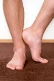 Healthy male feet with towel stepping. Towards the bathroom Royalty Free Stock Image