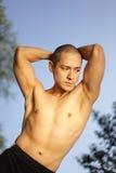 Healthy male flexing Stock Photos