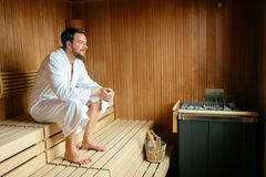 Healthy male in sauna relaxing. And enjoying wellness weekend royalty free stock photography