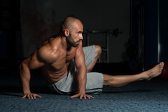 Healthy Man Doing Abdominal Excerise On Foor. Healthy Adult Man Exercising Abdominals On Foor royalty free stock photography
