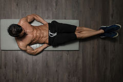 Healthy Man Doing Abdominal Excerise On Foor. Healthy Man Exercising Abdominals On Foor royalty free stock image