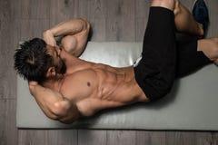 Healthy Man Doing Abdominal Excerise On Foor. Healthy Man Exercising Abdominals On Foor royalty free stock photos