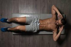 Healthy Man Doing Abdominal Excerise On Foor. Healthy Man Exercising Abdominals On Foor royalty free stock photo