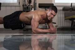 Healthy Man Doing Abdominal Excerise On Foor. Healthy Young Man Exercising Abdominals On Foor stock photography