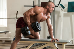 Healthy Man Doing Back Exercises With Dumbbell Stock Photography