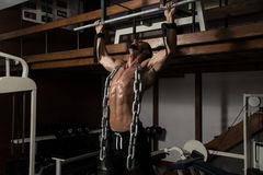 Healthy Man Doing Exercise For Back With Chain Royalty Free Stock Photography