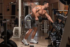 Healthy Man Doing Exercise For Back With Dumbbells Royalty Free Stock Images