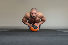 Healthy Man Doing Medical Ball Workout Stock Images