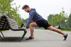 Healthy man doing stretch before jog Royalty Free Stock Image