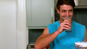 Healthy man drinking a smoothie stock video footage