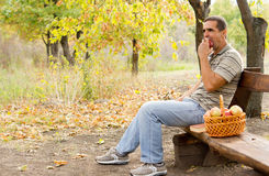 Healthy man eating an apple Stock Photo