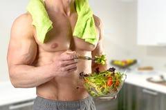 Healthy man eating a salad Royalty Free Stock Photos