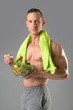 Healthy man eating a salad Stock Photography