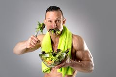 Healthy man eating a salad Stock Photo