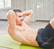 Healthy Man Exercising Abdominals On Foor. Healthy Man Exercising Abdominals On Foor royalty free stock images