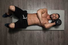 Healthy Man Exercising Triceps On Foor. Healthy Athlete Exercising Triceps On Foor As Part Of Bodybuilding Training stock photos