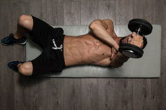 Healthy Man Exercising Triceps On Foor. Healthy Athlete Exercising Triceps On Foor As Part Of Bodybuilding Training stock images