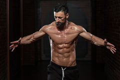 Healthy Man Flexing Muscles Royalty Free Stock Photography