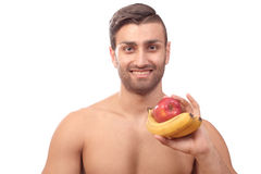Healthy man with fruits Stock Photos