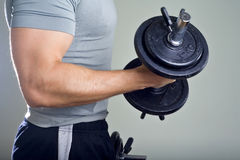 Healthy man hard workout in gym stock photography