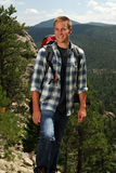 Healthy man hiking. A healthy man backpacking in the mountains Royalty Free Stock Images