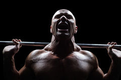 Healthy man lifting crossfit. Against black background Stock Photography