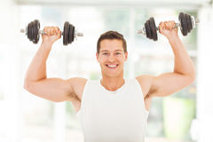 Healthy man lifting dumbbells Stock Image