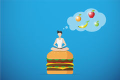 Healthy man meditating on hamburger and thinking of fruit, diet and health concept Royalty Free Stock Photography