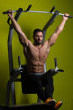 Healthy Man Performing Hanging Leg Raises Exercise Stock Photos