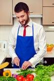 Healthy man preparing salad Stock Photo