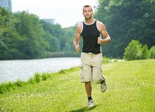 Healthy Man Running. Healthy young man running in the park Royalty Free Stock Images