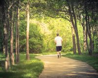 Healthy man running in the s-curved pathway in park near Dallas, Texas stock image