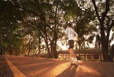 Healthy man runnung in the park. With sunlight Royalty Free Stock Photo