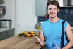 Healthy man sending text messages Stock Image