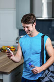 Healthy man sending text messages Royalty Free Stock Images