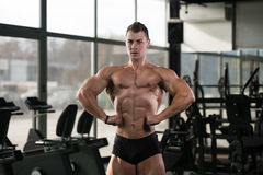 Healthy Man Showing Abdominal Muscle. Portrait Of A Young Physically Fit Man Showing His Well Trained Body - Muscular Athletic Bodybuilder Fitness Model Posing stock images