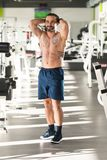 Healthy Man Showing Abdominal Muscle. Portrait Of A Young Physically Fit Tattoo Man Showing His Well Trained Body - Muscular Athletic Bodybuilder Fitness Model royalty free stock photo
